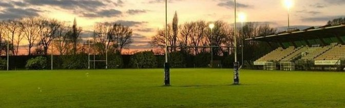 Our floodlit Number One Rugby Pitch with Grandstand