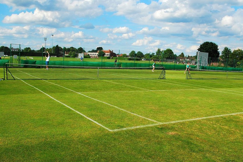 one of the six grass tennis courts at imber court